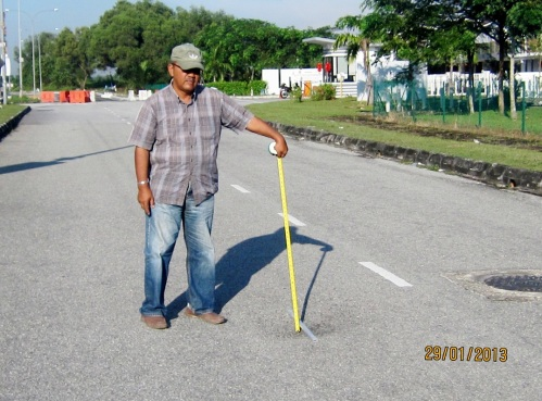 The deep of depression is about 75mm as measured by road contractor Aziz Ahmad